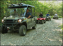 ATVs headed to a remote lake