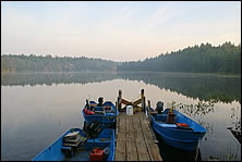 boats await at a remote lake